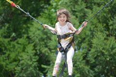 Little girl on a trampoline portrait royalty free stock photo