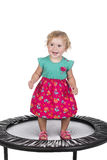 Little girl on trampoline Royalty Free Stock Images