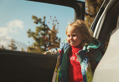 Little girl travel by car in mountains Stock Photography