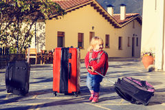 Little girl travel with suitcases, family tourism Stock Image