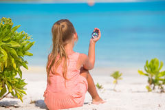 Little girl traveler with a compass in the hand on Royalty Free Stock Photo