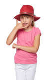 Little girl in traveler hat making a call me gesture Royalty Free Stock Image