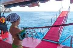 A little girl traveling across the Mediterranean sea on the ship Stock Image