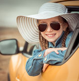 Little girl traveling by car Stock Photos
