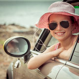 Little girl traveling by car Stock Images