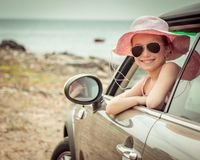 Little girl traveling by car Stock Image