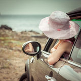 Little girl traveling by car. At sea back view Stock Photography