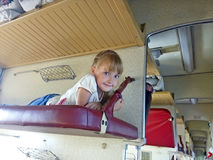 Little girl traveling in carriage Royalty Free Stock Image