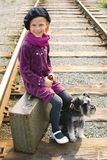 Little girl traveling with a dog Royalty Free Stock Image
