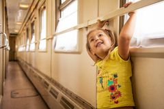 Little girl is travelling by train stock images