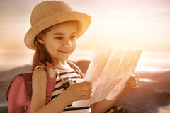 Little girl travels. Cute little girl travels with map stock photos