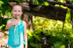 Little girl with treasure bottle. Casual portrait of little girl outdoors on summer day holding treasure bottle Stock Images