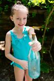 Little girl with treasure bottle. Casual portrait of little girl outdoors on summer day holding treasure bottle Stock Photos