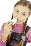 Little girl treat a runny nose Royalty Free Stock Photo