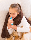 Little girl treating for rhinitis Royalty Free Stock Photography