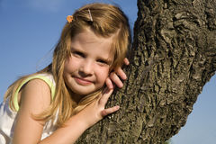 Little girl on the tree Royalty Free Stock Photo
