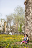 Little girl by the tree Stock Photos