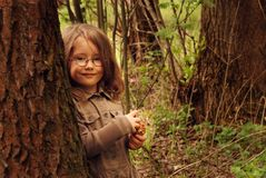 Little girl and a tree Royalty Free Stock Photo