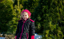Little girl at a tree farm Royalty Free Stock Photo