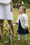 The little girl with a tricycle Royalty Free Stock Image