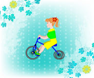 Little girl on a tricycle Royalty Free Stock Image