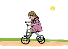 Little girl on a tricycle Stock Image