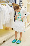 Little girl tries on short skirt Royalty Free Stock Photo