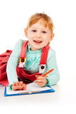 The little girl tries to draw Stock Photography