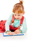 The little girl tries to draw Stock Photo