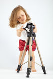 Little girl with tripod. On gray background Stock Photo