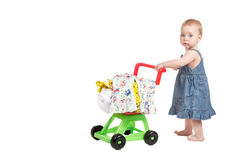 Little girl with a trolley royalty free stock image
