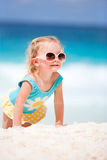 Little girl at tropical beach Stock Image