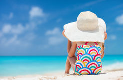 Little girl at tropical beach Stock Images