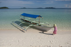 Little girl tropical beach FUN boat Royalty Free Stock Image