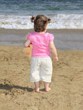 Little girl on a tropical beach Royalty Free Stock Image