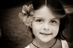 Little girl with tropical flower in her hair Royalty Free Stock Photo