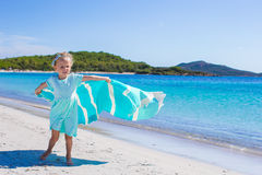 Little girl during tropical vacation have fun on Stock Images