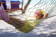 Little girl on tropical vacation relaxing in Royalty Free Stock Images