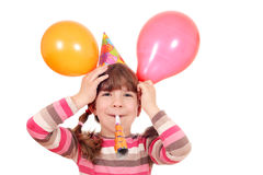 Little girl with trumpet and balloons birthday party Stock Photos