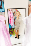 Little girl try on dress in fitting room Royalty Free Stock Photo
