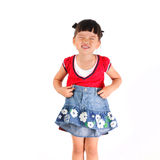 Little girl try skirt. Chinese little girl try skirt royalty free stock photo