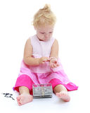 Little girl trying on jewelry Royalty Free Stock Image