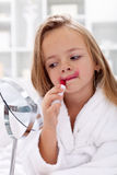Little girl trying lipstick Royalty Free Stock Photo