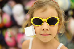 Little girl trying sunglasses in store Royalty Free Stock Photography