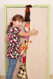 Little girl trying to close the closet Royalty Free Stock Photo