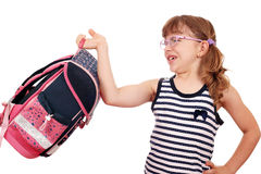 Little girl trying to lift schoolbag. Little girl trying to lift heavy schoolbag Royalty Free Stock Photos