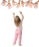Little girl trying to reach streched hands Royalty Free Stock Photo