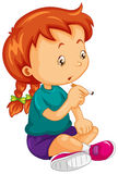 Little girl trying to smoke cigar Royalty Free Stock Photo