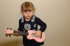 Young preschool girl with a ukulele stock photos