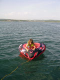 Little Girl Tubing Stock Photos